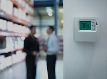 thermostat with employees talking in the background