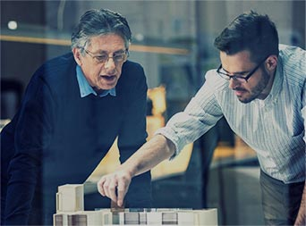 two men reviewing business plans