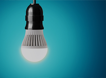 energy efficient lightbulb against blue background