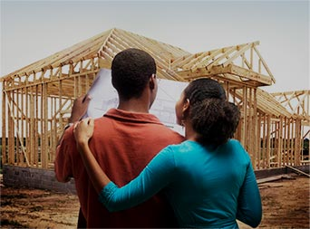 family looking at their new home construction